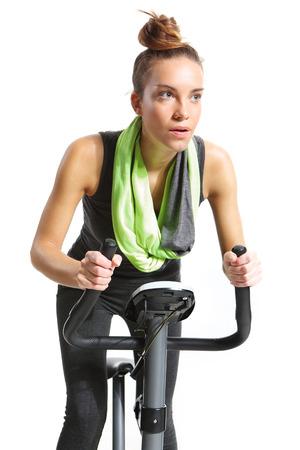 Girl exercising on exercise bike