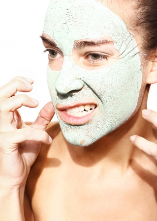 restlessness: evil woman in the mask with green clay  Stock Photo