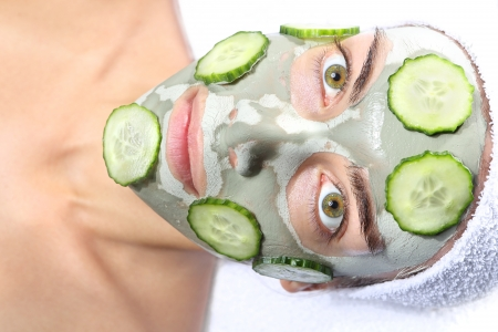 relaxes in the mask with green clay and cucumber  photo