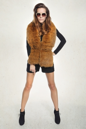 Pretty brunette in a vest with fur Stock Photo - 23833735