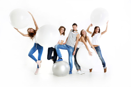 crazy man: The team of five young people dressed in white shirt and jeans posing with giant balloons