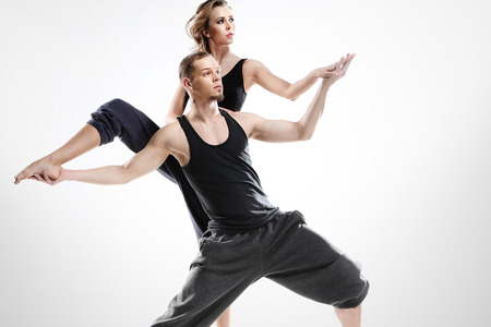 A couple of young dancers in a dynamic pose photo