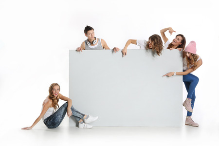 evaluating: Group of young people holding an empty white board with space for text