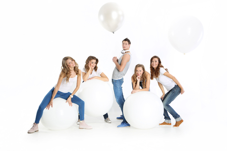 teen dance: Group of friends with big white balloons