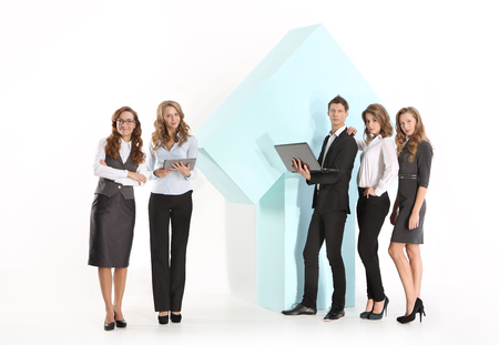 income tax: Group of young employees at a large arrow Stock Photo