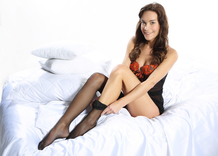 stockings feet: Sexy woman pulls stockings