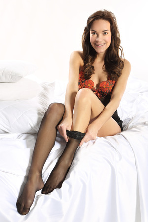 stockings feet: Shapely female legs in the dress of thin tights