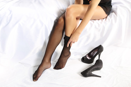 stocking feet: Dressing sexy stockings  Stock Photo