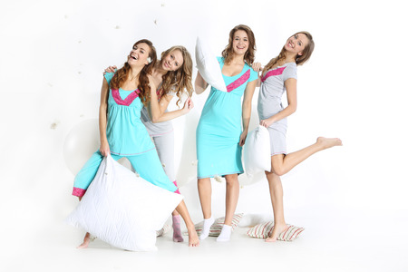pajama party: Beautiful young women in night dress on a white background