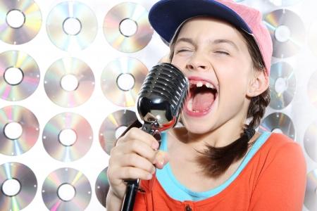 Singing girl in the orange cap photo