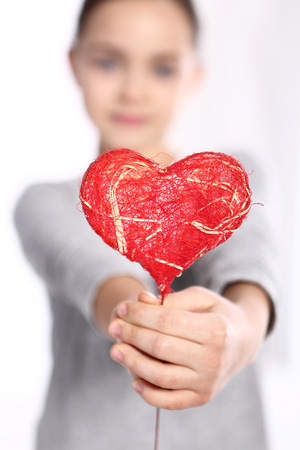 red hand: Portrait of a baby with a heart Valentine Stock Photo