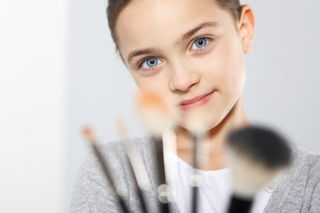 applied: Girl with brush for makeup Stock Photo