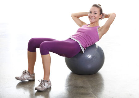 Woman exercising the muscles of the buttocks photo