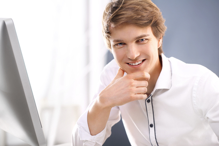 Success Young man smiling photo