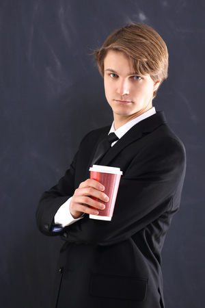 Boy in the jacket with a cup of coffee  photo