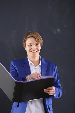 Smiling office worker with a file holder photo