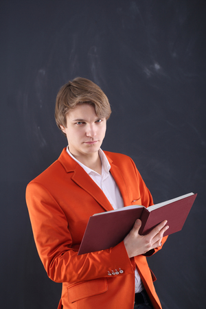 young teacher holding a book photo