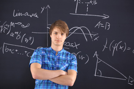 Mathematics, physics, chemistry-student at the blackboard  photo