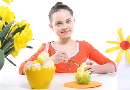 decorates: Girl decorates Easter eggs