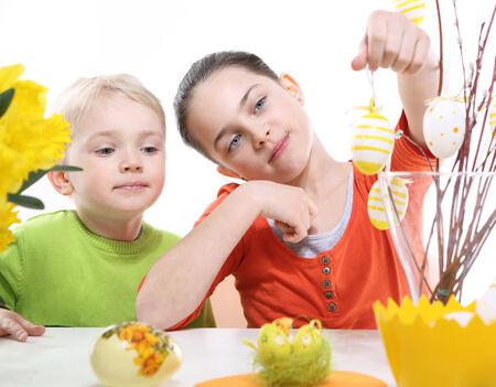 Family Easter- children decorates Easter eggs  photo