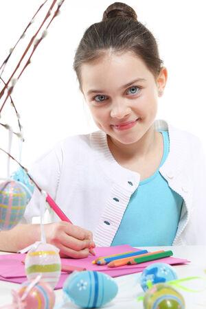decorates: Easter-child  decorates eggs  Stock Photo