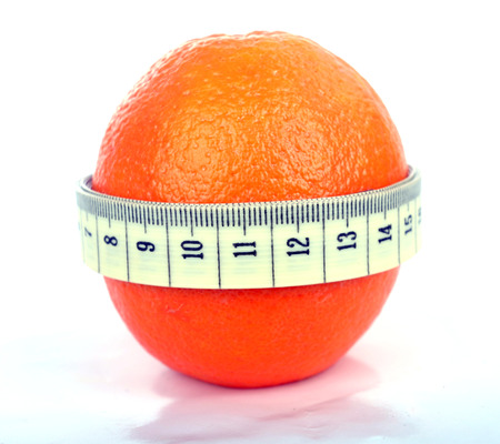 Supple orange with a tape measure - symbol of the fight against cellulite   Orange with tape measure