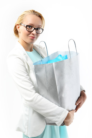 admires: Successful shopping - woman with a bag of purchasing