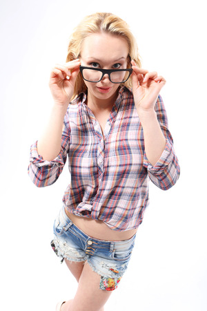 corrective: Corrective lenses a fashion accessory styling  Fashionable, sensual blonde girl in stylish glasses dressed in shirts and shorts Stock Photo