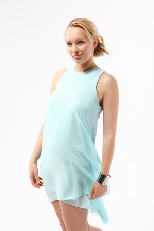skiff: Woman in blue, gauzy dress  Woman in pastels  Stock Photo