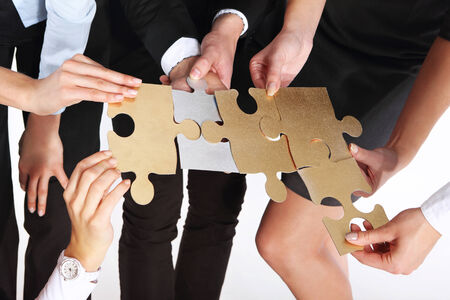 work experience: Group of people with silver gold puzzles Steel puzzle - silver, gold