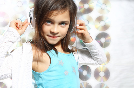 Musical child  Child, teen, girl, singing into a microphone, a small singer photo