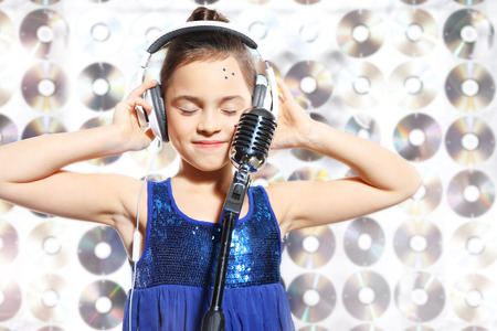 I love music  Child, teen, girl, singing into a microphone, a small singer Stock Photo - 29115731