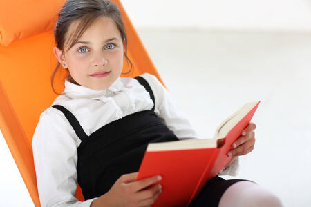 maturation: Girl reading a book Stock Photo