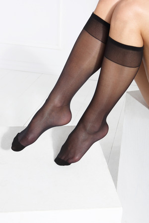 nylons: Socks . Female legs in tights, stockings, socks. on a white background