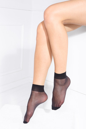 nylon: Female legs in tights stockings