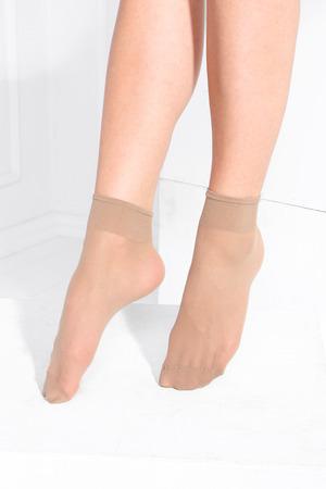 Vrouwelijke benen in panty kousen