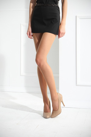 pantyhose: Sexy female legs, Female legs in tights, stockings, socks. on a white background