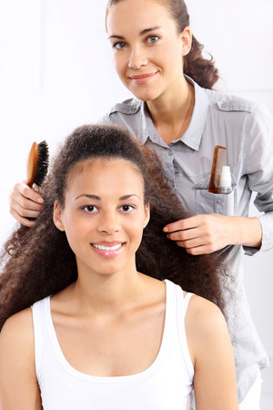 hair stylist: Hairdresser  African woman at the hairdresser