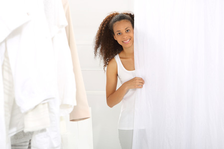 mulatto woman: A mulatto woman shopping in a clothing boutique,