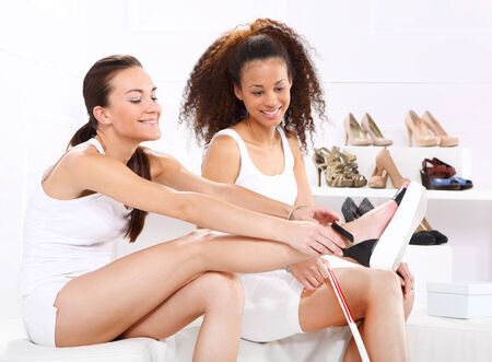 show off: Smiling women try shoes
