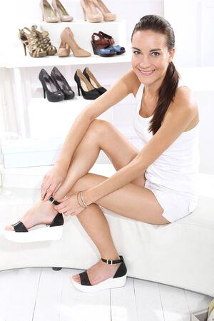 bargain: Women buy shoes Stock Photo