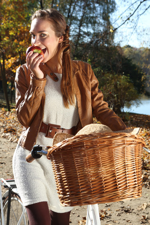 Portrait of a beautiful woman in autumn scenery . photo