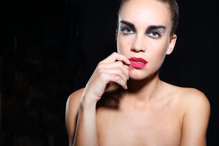 smeared: Sad woman in makeup smudged, smeared red lipstick