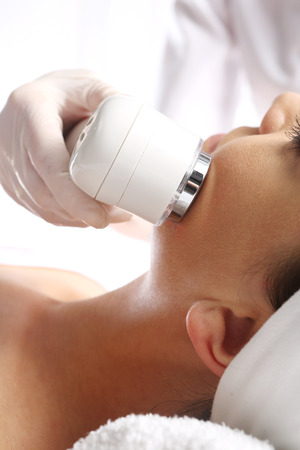 aha: Ultrasound beauty treatment Stock Photo