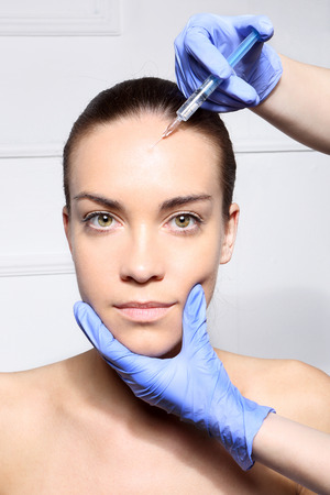 injected: Portrait of a white woman during surgery filling facial wrinkles, Cosmetic is injected into facial skin cosmetics