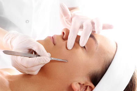 Plastic surgery, a woman in the clinic of aesthetic surgery photo