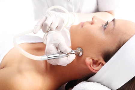 healthcare and beauty: Relaxed woman during a microdermabrasion treatment in beauty salon Stock Photo