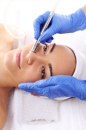 treatment: Relaxed woman during a microdermabrasion treatment in beauty salon Stock Photo