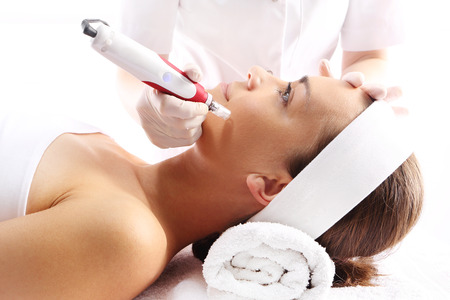 beauty skin: Rejuvenation, beautification, the woman at the beautician, Mesotherapy microneedle