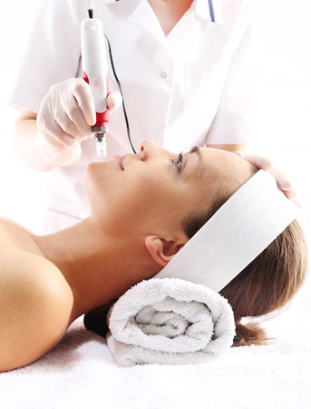 Rejuvenation, beautification, the woman at the beautician, Mesotherapy microneedle photo